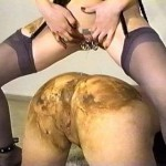 Two scat lesbians are performing a dirty piss and poo session